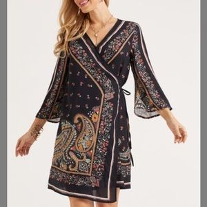 NWOT wrap dress with asymmetric hem.
